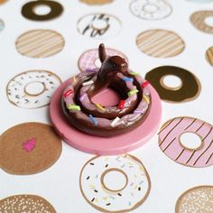 Miniature Donut Snake. Handmade, Polymer Clay Figurine, Crafted by The Clay Kiosk on Etsy.
