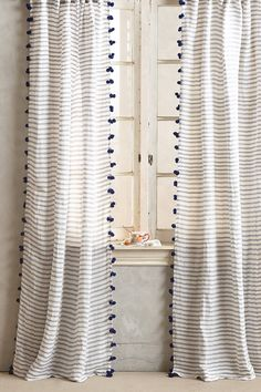 Can sooo do this!  pompon tassel curtain #anthrofave
