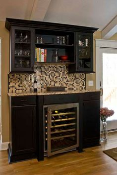 Awesome wine bar. Solution for the fridge being deeper then the cabinets!!!! Yay