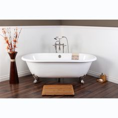 @Overstock - White Cast Iron Double-ended 66-inch Clawfoot Bathtub - Modeled after the original construction of claw foot tubs, this this classic design offers warmth, comfort and durability with its traditional cast iron make up. Complete with brass ball and claw feet, the style of this tub is timeless.  http://www.overstock.com/Home-Garden/White-Cast-Iron-Double-ended-66-inch-Clawfoot-Bathtub/7990335/product.html?CID=214117 $1,299.99