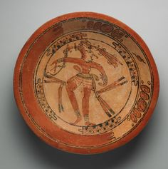 "Mayan plate with dancing maize god, 600–800 AD, Late Classic, 'Tikal Dancer' style. Ceramic with polychrome slip. H: 7.0 cm, D: 33.6 cm. (2 3/4 x 13 1/4""). From the Tikal, Maya area, Petén, Guatemala 
