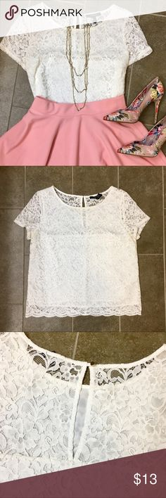 White lace Forever 21 top size M Forever 21 size M white lace boxy short sleeve top. Lightly worn condition but still has lots of life left! Keyhole closure in back with gold button. Seller is a nonsmoker.  ✅nonsmoker  🚫no modeling! 🚫no trades!  Please be courteous when making offers and remember that Poshmark takes 20% of each order! Forever 21 Tops Blouses