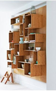 Love this kitchen storage/display idea - would be a great place to store my burgeoning collection of enameled kitchen wares