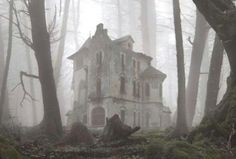 Abandoned Gothic Victorian house in the fog