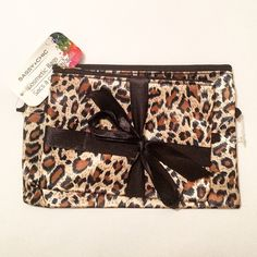 NWT! Cosmetic Bags ⚠️ NEVER BEEN USED! Silky material, still wrapped together. 2 cheetah/leopard print bags with zipper openings  Sassy + Chic Bags