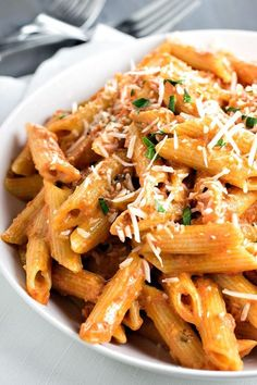 Penne Alla Vodka! Skip the restaurant and make the best penne alla vodka at home. This recipe has enough tomato to give the sauce a nice kick without overpowering the cream!   HomemadeHooplah.com