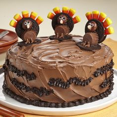 Turkey Cake -- 1 Classic Yellow Cake Mix- 1c water- 1c pumpkin- 2 eggs- 2t pumpkin pie spice- can Frosting Creations Frosting Starter- pack Frosting Creations Chocolate Almond Flavor Mix- can Creamy Home Style Dark Chocolate Fudge Frosting- 6 Double Cream Filled Chocolate Sandwich Cookies- 3 PB filled chocolate cups- 1 bag candy corn- box chocolate covered caramel candies -- visit site for instructions