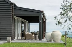Backyard to Die For at a Modern Barn House in New Zealand A stunning place to escape, rest, unwind. Modern Barn House, Modern House Design, House Cladding, Shed Homes, Porches, Ideal Home, House Colors, Exterior Design, Building A House