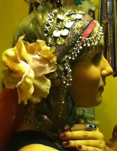 fun tribal belly dance headdresses made from other belly dance accessories and other around the house items.  http://shimmiesandglitter.wordpress.com/2011/12/30/tribal-headress-fun/#
