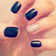 Black nails with glittery gold accent.