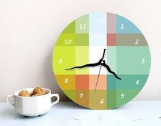 Living room or office: This is pretty cool. Wall clock soft pastel aqua turquoise green by ArtisEverything, $49.00