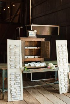 rustic shutter escort card displa at a Barn wedding at Riverside on the Potomac by Katelyn James Photography