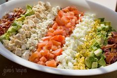 Layers of hard boiled eggs, bacon, blue cheese, tomatoes and avocado make up the classic Cobb Salad. This attractive salad would make a beautiful addition to your Easter table. You can modify the ingredients to Lunch Recipes, Great Recipes, Salad Recipes, Cooking Recipes, Favorite Recipes, Healthy Recipes, Weight Loss Meals, Weight Watchers Meals, Losing Weight
