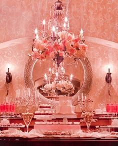  wow! What a table.. Love the wallpaper and the chandelier. pink