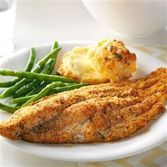 Cajun Baked Catfish Recipe -Jim Gales' well-seasoned fish nets him compliments from family and friends in Glendale, Wisconsin whenever he serves it. The fish is moist and flakey, the coating crisp, crunchy and flecked with paprika.