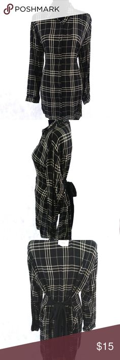 "Zara Trafaluc Plaid Shirt Dress Sz S Zara Trafaluc Collection Black White Plaid Button Long Sleeve Shirt Dress S  This item is new with tags the tag is torn. One strap that holds the sash is undone see pics.  Approximate Measurements:  Pit to Pit: 42""*  Shoulder to Shoulder: 19""  Length: 32""  Sleeve Length: 22""  Item is measured laying flat. Measurements with an asterisk * next to them have been doubled. Zara Dresses Long Sleeve"