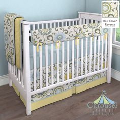 Crib bedding in Solid Banana, Spa Pom Pon Play, Solid Robin's Egg Blue. Created using the Nursery Designer® by Carousel Designs where you mix and match from hundreds of fabrics to create your own unique baby bedding. #carouseldesigns