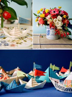 beautiful flowers arranged in tin can + paper sailboat place cards - LOVE.