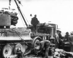 Repair work on the replacement engine 'Maybach' HL210 tank 'Tiger' № 141 (Pz.Kpfw. VI Ausf.E) 1st Company of the 501st Heavy Tank Battalion Wehrmacht (s.Pz.Abt.501).