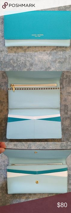Henri Bendel wallet Multiple shades of blue trifold wallet with 10 compartments for cards and zippered for change henri bendel Bags Wallets