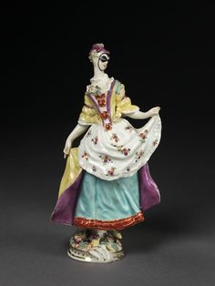 1760-69.  Unlike many Continental factories, the Chelsea porcelain factory was not backed by aristocratic patronage. Nevertheless, it had great ambitions. It used a rich glassy soft-paste body to make copies of contemporary Meissen figures. The Flemish modeller Joseph Willems produced a successful range of original models. They included these 'masqueraders', who are based on the masked revellers to be seen at the London pleasure gardens of Vauxhall and Ranelagh.