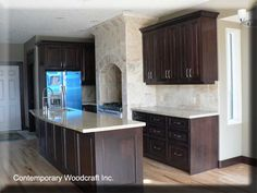 More dark cabinets with light wood flooring. Yes . . . . I definitely want this. Plus this stove hearth is pretty amazing too!