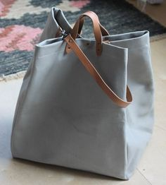 b4e76d8d42f5 spacious canvas tote with leather handles Shoulder Straps