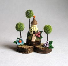 Hey, I found this really awesome Etsy listing at https://www.etsy.com/listing/235810222/miniature-whimsy-fairy-house-with-trees