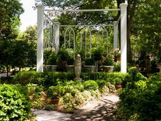 Set off your sculptures in a section of the garden with another sculpture, such as an arbor, pergola, gazebo or trellis. This outdoor room, by garden designer Susanne Hudson, incorporates Gothic-style church windows.