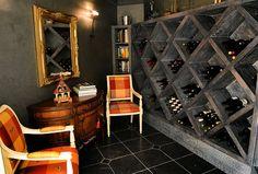 Wine cellar with wine racks and gilt mirror