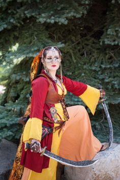 Steampunk Ottoman Sword Dancer  Entari, Yelek and Sirwal by Donna Cucheran and Sarah, The Petite Lady of Steam Headdress, clock and gear hand flowers and spats by Sarah, The Petite Lady of Steam Vest by Persian Punkette Photo by SeyeCo Images