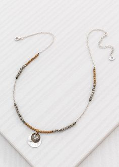 """Earn Your Stripes Necklace 3540Alternating sections of metallic beads and the perfect Pendant create a design you deserve! Brass, Cubic Zirconia, Pyrite, Sterling Silver.  Adjusts: 16.00"""" - 18.00""""  Material: Brass, Cubic Zirconia, Pyrite, Sterling Silver"""
