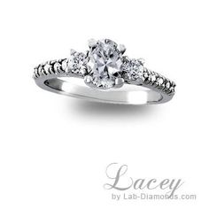 Be proud of the ring you give her when you give her an engagement ring from Lab-Diamonds.com! She'll truly love our Lacey with a round-cut center stone accented by two side stones and diamond simulants on the shank. From now until the end of June this ring is only $780.00 plus FREE shipping! To order our Lacey call 1-800-682-0581 or visit http://www.lab-diamonds.com/lacey-lab-created-engagement-ring.html