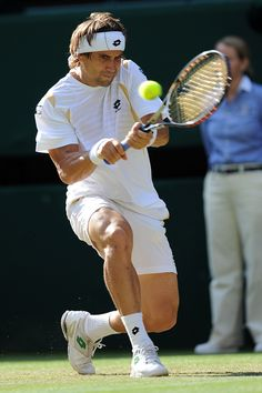 David Ferrer connects on a backhand during his third round match against Andy Roddick. - Neil Tingle/AELTC
