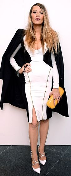 Blake Lively: New York Fashion Week The new mom modeled her post-baby body in a black and white Gabriela Cadena dress with leather panels, paired with crisscrossed heels and a mustard clutch at the designer's fall 2015 runway show.