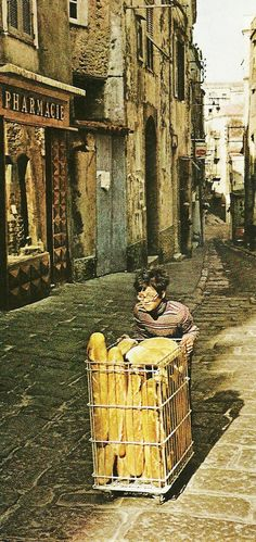 Baker's delivery boy in streets of Bonifacio, Corsica National Geographic | April 1963
