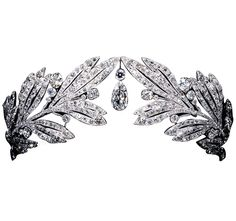 Tiara of Marie Bonapart, Cartier, 1907, diamonds, platinum, consisting of twin pave set diamond olive branches meeting at a pear shaped diamond in the centre. The neo-classical tiara was particularly suitable for Marie Bonaparte (1882-1962) for it evoked the tiaras worn by the Bonaparte women during the First Empire of Napoleon I. As if to emphasises her background Princess Marie wore her tiara low on the brow just as the Empress Josephine had done. http://www.diamonddivas.be/index.php?id=37
