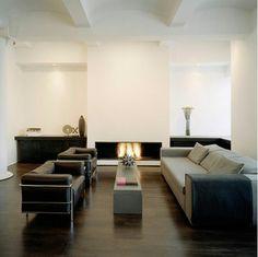 dark wood floors with white walls