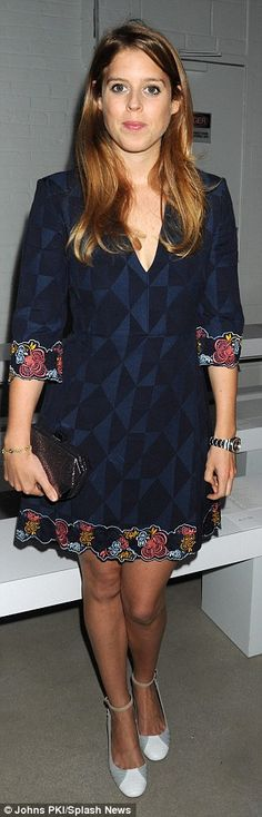 The royal fashion fan showed off her trim figure in a form-fitting blue dress with bold fl...