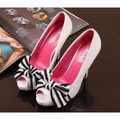 White heels. Love the stripy bows