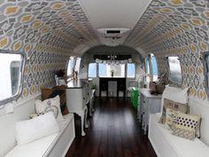 1975 Air stream, bead board and stencil interior. Camper Interior Decorating Ideas - Unique RV Decorating Ideas - Country Living