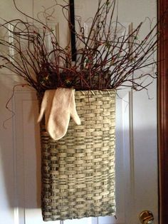Love the white basket filled with vines and a sweet pair of mittens.