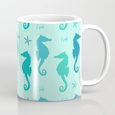 Illustration pattern of blue and mint green seahorse silhouettes on a green background. © Amalia Ferreira-Espinoza www.afeimages.ca Available in 11 and 15 ounce sizes, our premium ceramic coffee mugs feature wrap-around art and large handles for easy gripping. Dishwasher and microwave safe, these cool coffee mugs will be your new favorite way to consume hot or cold beverages.