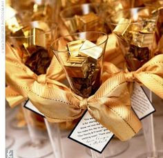 The escort cards -- mini champagne bottles with cards attached showing the couple's puppy attached to them -- were part one of the favor. Part two came just before the toasts, as guests were handed glass champagne flutes filled with truffles.