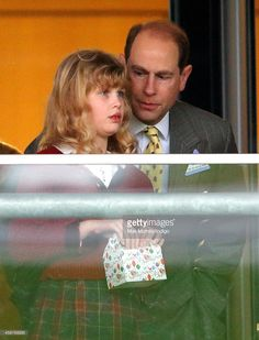 Prince Edward, Earl of Wessex and his daughter Lady Louise Windsor watch the racing as they attend the Christmas Meeting at Ascot Racecourse on December 21, 2013 in Ascot, England.