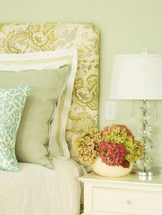 The timeless muted print of the upholstered headboard lends a soothing touch of elegance to this bedroom.