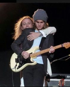 Father and son Robin Zander and Robin Taylor