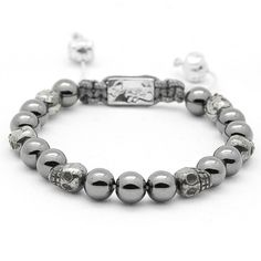 New 8 mm Bracelet: Hematite, Pyrite Skulls, Sterling Silver closing system. More colors available