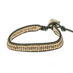 This single wrap bracelet has green and gold metal beads with green leather and a button closure. It can be worn at 6 or 7 inches. * Marlee's Designs * Boheme Collection Single Wrap Bracelet   Marlee's by Tappers   Novi   West Bloomfield   Troy   Michigan