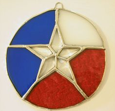 """Handmade stained glass suncatcher using the """"Tiffany"""" copper foil method and featuring a beveled star in the center to represent The Lone Star State. Stained Glass Designs, Stained Glass Patterns, Mosaic Glass, Glass Art, Texas Star, Lone Star State, Kamala Harris, Yellow Roses, Suncatchers"""